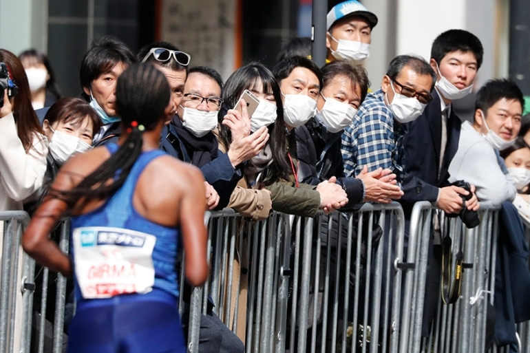 Organisers of the Tokyo Marathon reduced the number of participants out of fear of the spread of the coronavirus [Shuji Kajiyama/AP]