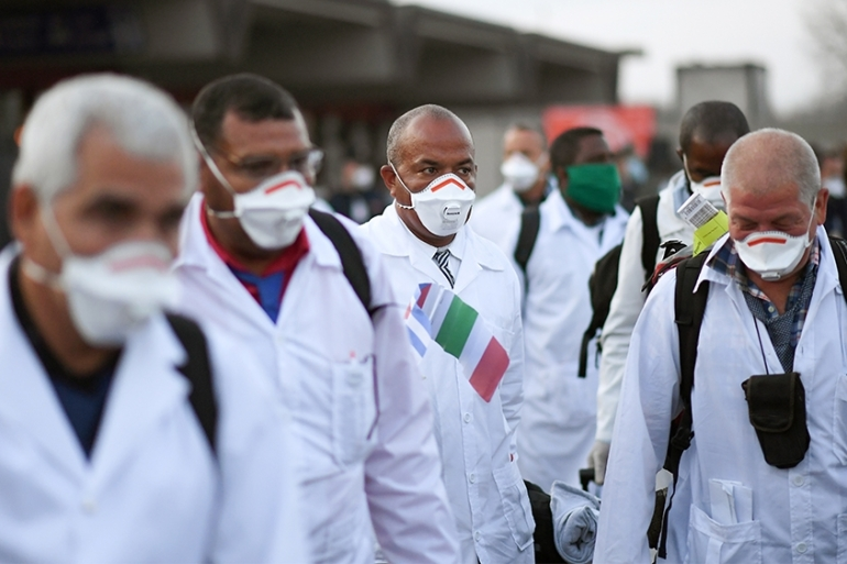 An emergency contingent of Cuban doctors and nurses arrive in Italy to help fight the battle against the spread of coronavirus, on March 22, 2020 [Daniele Mascolo/Reuters]