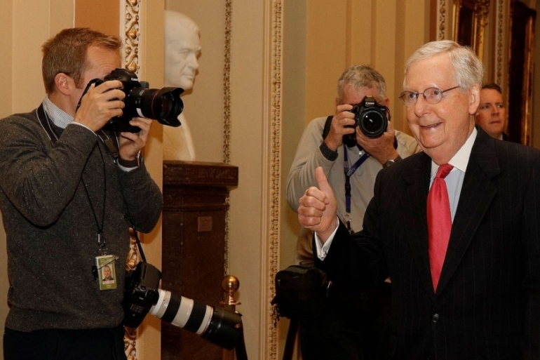 US Senate Majority Leader Mitch McConnell gives a thumbs up after Congress agreed to a $2 trillion coronavirus economic stimulus package in Washington, US, on March 25, 2020 [Tom Brenner/Reuters]