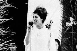 Djamila Bouhired at age 25, at a meeting of the Algerian National Liberation Front in June 1962 [File: AP]
