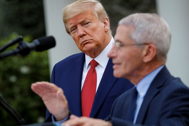 NIH National Institute of Allergy and Infectious Diseases Director Anthony Fauci speaks as US President Donald Trump listens during a news conference in the Rose Garden of the White House [File: Al Drago/Reuters]