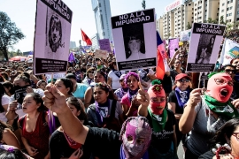 Women demonstrate during a march on International Women's Day in Santiago [Martin Bernetti/AFP]