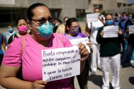 Medical workers of the IMSS protest to demand better PPE to treat COVID-19 patients outside a hospital in Ciudad Juarez, Mexico [Jose Luis Gonzalez/Reuters]