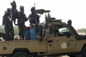 Soldiers of the Chad Army sit on the back of a Land Cruiser at the Koundoul market, 25 km from N'Djamena [File: AFP]