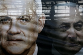 A banner depicts Benny Gantz, leader of Blue and White alliance and Israel Prime minister Benjamin Netanyahu, in Tel Aviv, Israel on February 17, 2020 [Ammar Awad/Reuters]