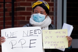 Nurses at the Montefiore Medical Center Moses Campus demand critical PPE to handle patients during the coronavirus outbreak in the Bronx borough of New York City, in the US [Brendan Mcdermid/Reuters]