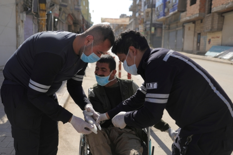 WHO has steered most of its anti-coronavirus help through Bashar al-Assad's government [Rodi Said/Reuters]