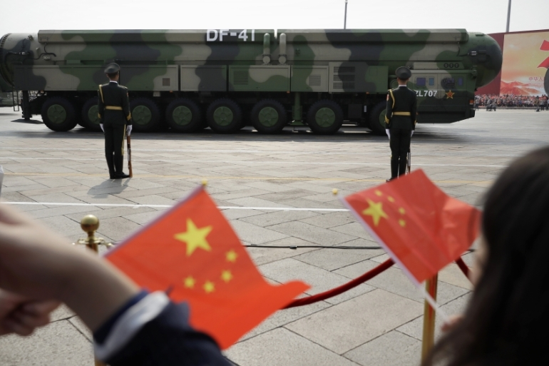 China says it has been actively fulfilling commitments to treaties on arms control [Mark Schiefelbein/AP]