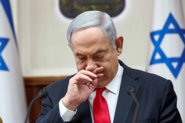 Israeli Prime Minister Benjamin Netanyahu gestures as he chairs the weekly cabinet meeting in Jerusalem on March 8, 2020 [File: Oded Balilty/Reuters]