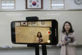 Schools are reopening in South Korea after weeks of closure during the coronavirus outbreak, but classrooms will remain empty with teaching taking place online rather than face-to-face [Ahn Young-joon/AP Photo]