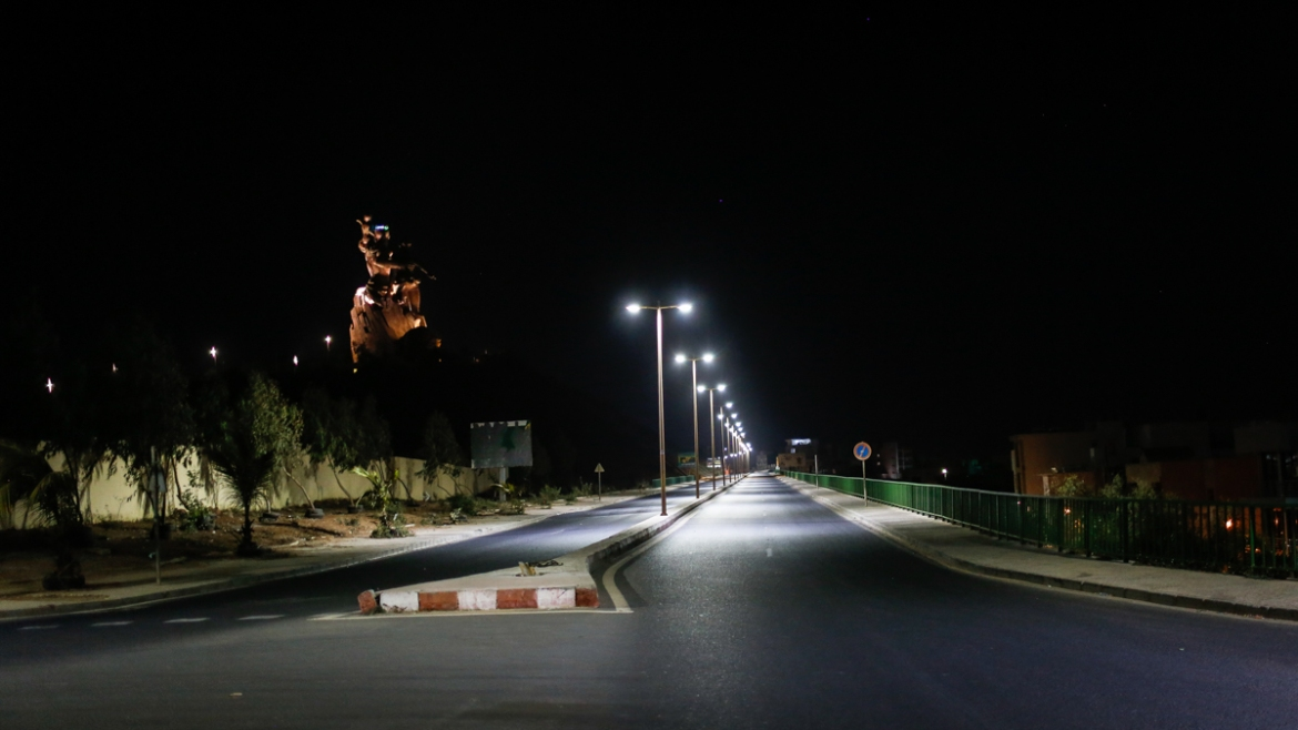 Dakar's arterial corniche road that skirts the Renaissance Monument is empty during the curfew that has been extended to May 4.[Maya Hautefeuille/Al Jazeera]