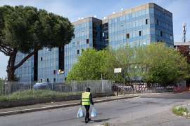 The locked-down, quarantined Selam Palace, is home to around 500 people in southern Rome [Valerio Muscella/Al Jazeera]