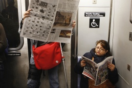 A woman sits on a chair for people with disabilities on the subway in New York [File: Reuters]