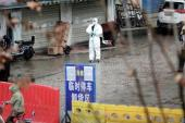 A worker in a protective suit is seen at the closed seafood market in Wuhan, China [File: Reuters]