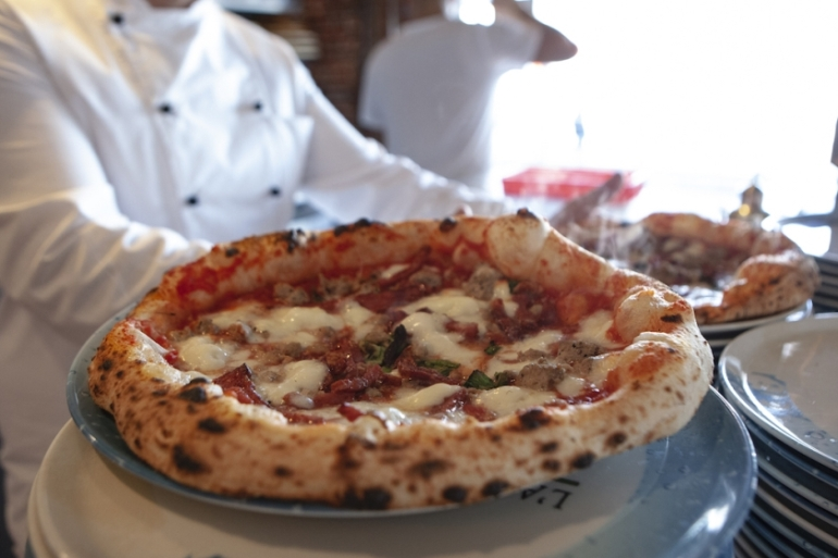 A tall pizza crust is the latest outcome of pizzaiolos' experimentations on dough and leavening in Naples [Daniela De Lorenzo/Al Jazeera]
