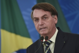 Bolsonaro insists coronavirus is a minor problem that shouldn't interfere with the country's economy [Andre Borges/AP]