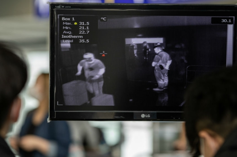 Hong Kong quickly started thermal imaging of passengers arriving at its international airport. Now overseas arrivals are required to complete a 14-day quarantine monitored by a mandatory app [Jerome Favre/EPA]