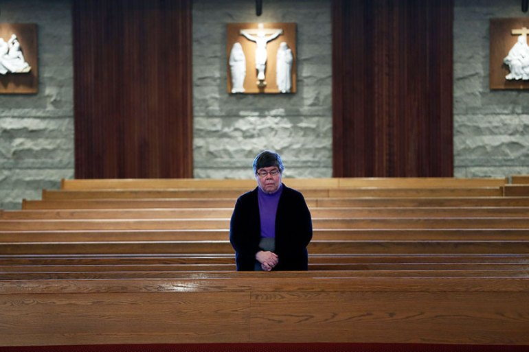A nun prays during the broadcast and recording of Palm Sunday Mass at a Catholic church in Ankeny, Iowa. Church services have been cancelled and moved online during the coronavirus pandemic [Charlie Neibergall/AP Photo]