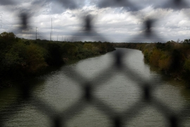 A view of the Rio Bravo, the natural border between the United States and Mexico, is seen from behind a fence at the McAllen-Hidalgo international bridge in Reynosa, Mexico [File: Tomas Bravo/Reuters]