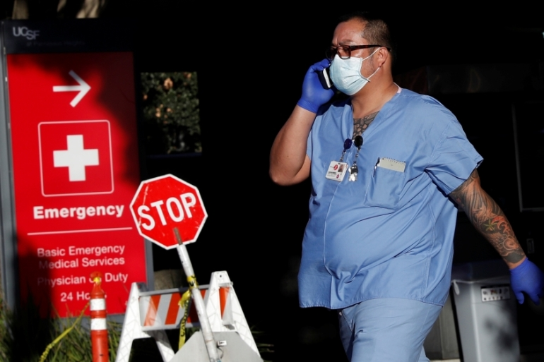 A hospital worker at the University of California San Francisco Parnassus campus in San Francisco amid the COVID-19 outbreak [Shannon Stapleton/Reuters]