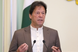 Imran Khan said if Pakistan accepted Israel and ignored the oppression of the Palestinians, 'we will have to give up Kashmir as well then', adding that this was not something Pakistan could do [File: Lim Huey Teng/Reuters]