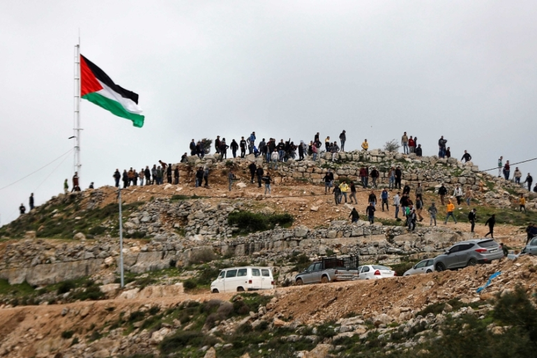 Palestinian demonstrators gather on a hilltop during a protest against Israeli settlements in the town of Beita in the occupied West Bank on March 2, 2020 [File: Reuteres/Mohamad Torokman]