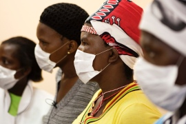Patients with HIV and TB wear masks while awaiting consultation at a clinic in Khayelitsha township, South Africa [File: Reuters]