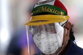 A health worker wearing a protective face mask at a coronavirus drive-thru testing station in Monterrey, Mexico [Daniel Becerril/Reuters]