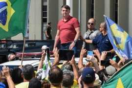 Bolsonaro joining supporters who were taking part in a motorcade to protest against quarantine and social distancing measures in Brasilia on April 19 [Evaristo SA/AFP]