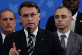 Bolsonaro speaks during a news conference on the resignation of Justice Minister Sergio Moro in Brasilia [Eraldo Peres/AP]