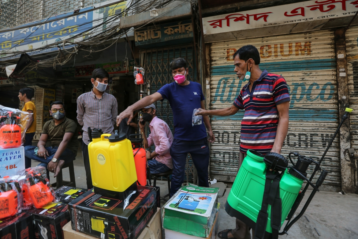 On Dhaka's Nawabpur Road, sales of sprayers have spiked as people buy them for use in homes or on the streets. [Mahmud Hossain Opu/Al Jazeera]