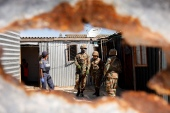Soldiers and police patrol in Khayelitsha, South Africa, as authorities attempt to enforce a 21-day nationwide lockdown aimed at limiting the spread of the new coronavirus [Reuters/Mike Hutchings]
