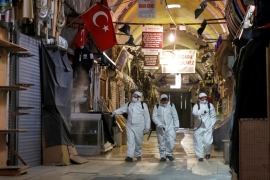 Workers spray disinfectant at the Grand Bazaar in Istanbul, Turkey to prevent the spread of the coronavirus [Umit Bektas /Reuters]