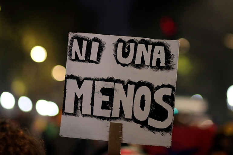 A demonstrator holds a sign that reads 'Not one (woman) less' during a protest against femicides and violence against women in Buenos Aires, Argentina [File: Marcos Brindicci/Reuters]