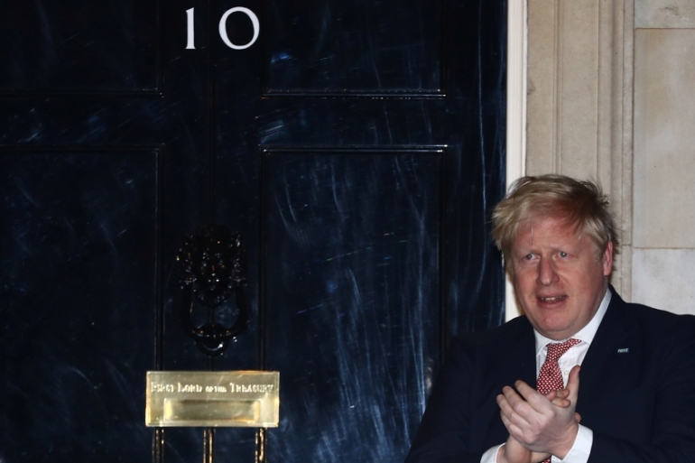 Boris Johnson applauds outside 10 Downing Street during the Clap For Our Carers campaign in support of the NHS, as the spread of COVID-19 continues in London, UK, March 26, 2020 [Hannah McKay/Reuters]