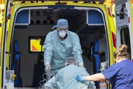 NHS workers in PPE take a patient with an unknown condition from an ambulance at St Thomas' Hospital on April 10, 2020 in London, England [File: Justin Setterfield/Getty Images]