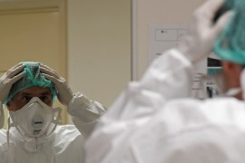 An Italian medic prepares for another shift fighting the coronavirus pandemic [Alberto Lingria/Reuters]