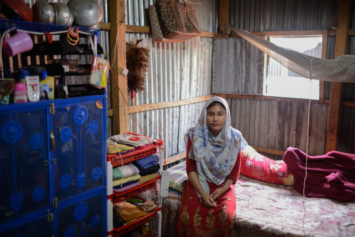 Rahima used to work at a diagnostics centre. She was laid off without pay and notice in March, at the onset of the outbreak. She worries constantly about how she will manage rent and the expenses of her family, who live with her in the Korail slum, Dhaka. [Mahmud Hossain Opu/Al Jazeera]