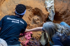 Members of Ukuthula Trust, a local NGO of pathologists and community workers, exhume the skeletal remains of Justin Tshuma and Thembi Ngwenya in Tsholotsho district [File: Tendai Marima/Al Jazeera[
