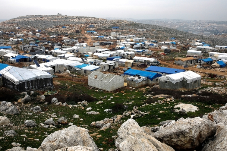 The makeshift shelters of internally displaced Syrians are seen from a hilltop as part of an IDP camp located in Sarmada, Idlib province [File: Umit Bektas/Reuters]