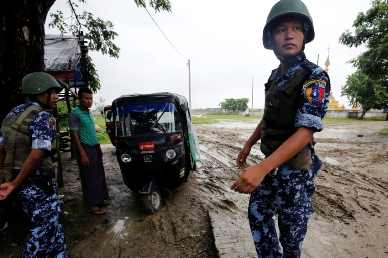 Myanmar police officer stands guard in Maungdaw, Rakhine State on July 9, 2019 [File: Ann Wang/ Reuters]