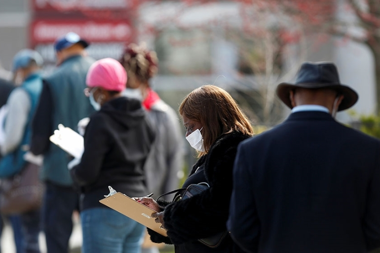 People wait in line to receive testing during the global outbreak of the coronavirus disease (COVID-19) outside Roseland Community Hospital in Chicago, Illinois [Joshua Lott/Reuters]