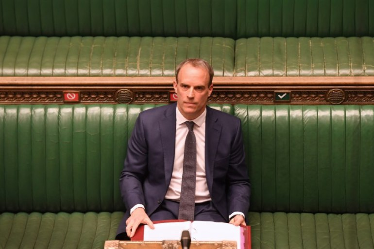 United Kingdom Foreign Secretary Dominic Raab deputised for Boris Johnson on Wednesday at a socially-distanced Prime Minister's Questions session, where he faced criticism over the government's response to the coronavirus pandemic [Jessica Taylor/Handout/UK Parliament/Reuters]
