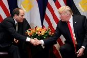 US President Donald Trump shakes hands with Egypt's President Abdel Fattah el-Sisi as they hold a bilateral meeting in New York, US, September 24, 2018 [Carlos Barria/Reuters]
