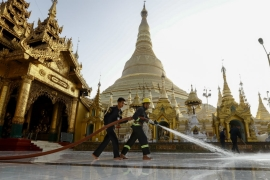 Myanmar began a flurry of disinfection, including at the Shwedagon pagoda in Yangon, as the country reported its first cases - and first death- from COVID-19 [Lynn Bo Bo/EPA]