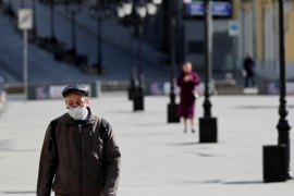 A man wearing a protective face mask walks along the street, as the spread of COVID-19 continues, in Moscow, Russia [Shamil Zhumatov/Reuters]