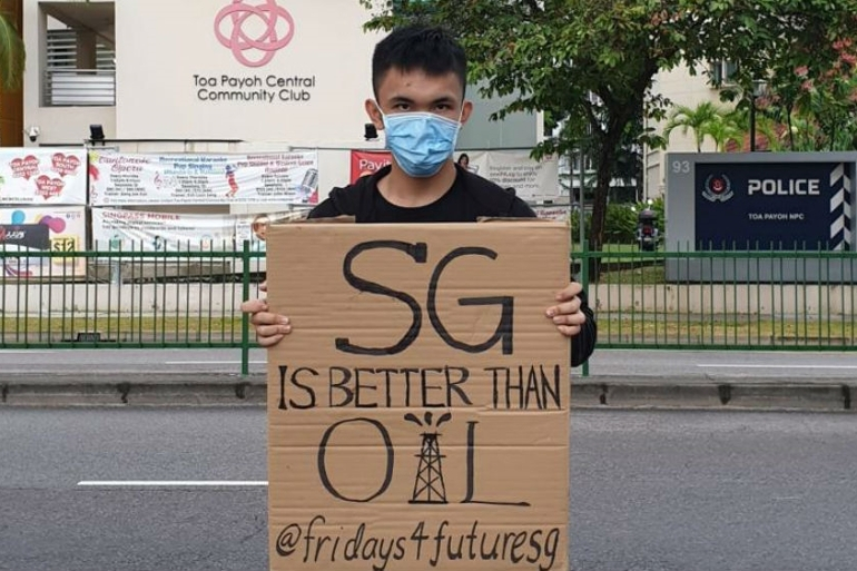 "On 22 March, a photo of 20-year-old Nguyen Nhat Minh holding up a placard in public saying ""SG IS BETTER THAN OIL @fridays4futuresg"" was posted on Fridays for Future Singapore's Instagram account. The account has now been made private [Supplied]"