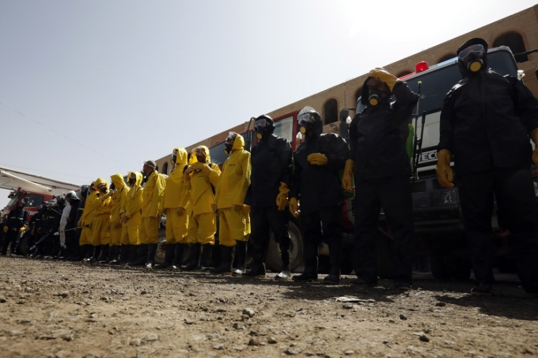 The staff of the Yemeni civil defence prepare to spray disinfectant in the capital Sanaa [Yaya Arhab/EPA-EFE]