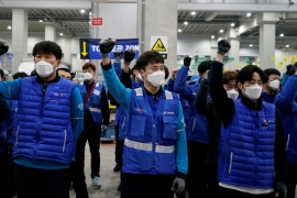 A group of Coupang delivery workers prepares to go to work; the coronavirus outbreak has increased their workload but stalled talks on improving working conditions [Kim Hong-Ji/Reuters]