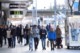 People walk in Stockholm, Sweden, where the government has not imposed a lockdown, unlike other European countries, on April 4, 2020. [Henrik Montgomery/TT News Agency via Reuters]